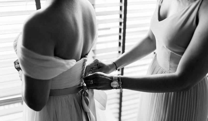 wedding planner helping bride